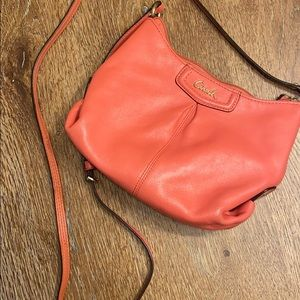Coral/pink coach crossbody bag